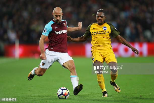 Pablo Zabaleta of West Ham United and Jose Izquierdo of Brighton and Hove Albion battle for the ball during the Premier League match between West Ham...