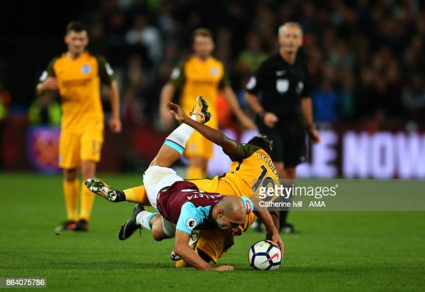 Pablo Zabaleta of West Ham United and Jose Izquierdo of Brighton and Hove Albion get tangled up during the Premier League match between West Ham...