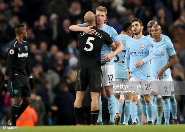 Pablo Zabaleta of West Ham United and Kevin De Bruyne of Manchester City hug after the Premier League match between Manchester City and West Ham...