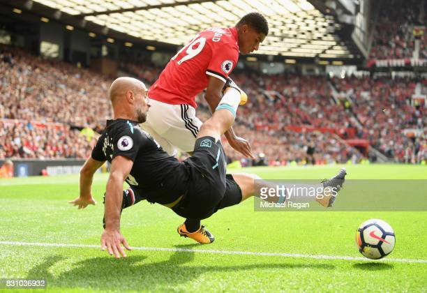 Pablo Zabaleta of West Ham United and Marcus Rashford of Manchester United battle for possession during the Premier League match between Manchester...
