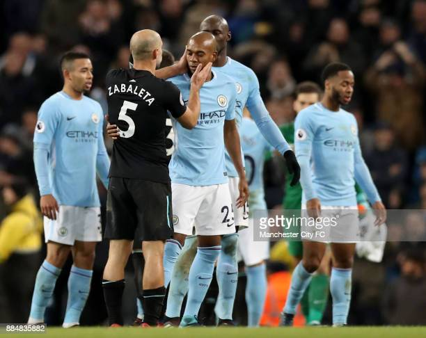Pablo Zabaleta of West Ham United and mc25 hug after the Premier League match between Manchester City and West Ham United at Etihad Stadium on...