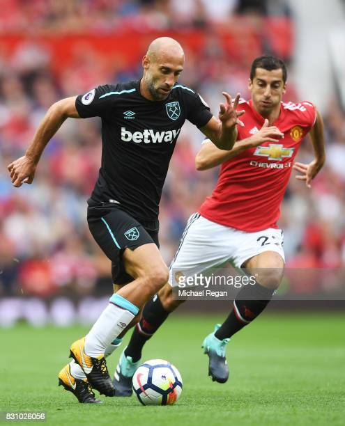 Pablo Zabaleta of West Ham United attempts to get past Henrikh Mkhitaryan of Manchester United during the Premier League match between Manchester...