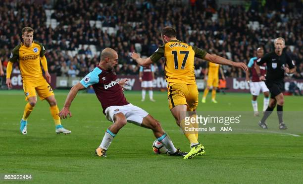 Pablo Zabaleta of West Ham United brings down Glenn Murray of Brighton and Hove Albion leading to a penalty during the Premier League match between...