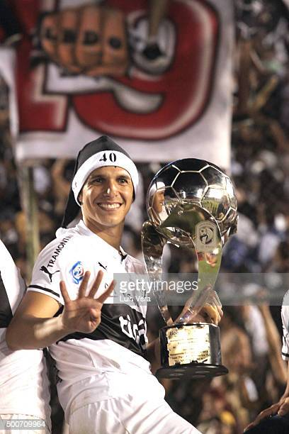 Pablo Zevallos of Olimpia celebrates with the trophy after winning a playoff final match between Cerro Porteño and Olimpia as part of Torneo Apertura...