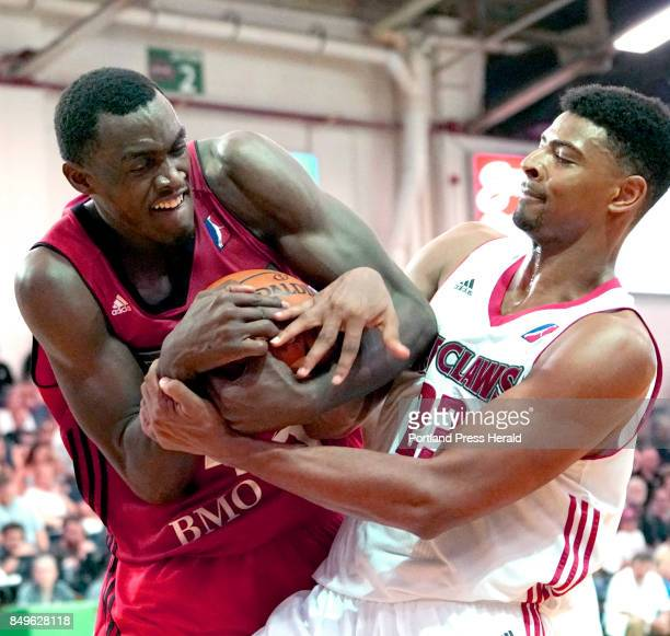 Pacal Siakam of the 905 Raptors fights with Maine's Jordan Mickey for control of a rebound during the second half of an NBA DLeague playoff game...