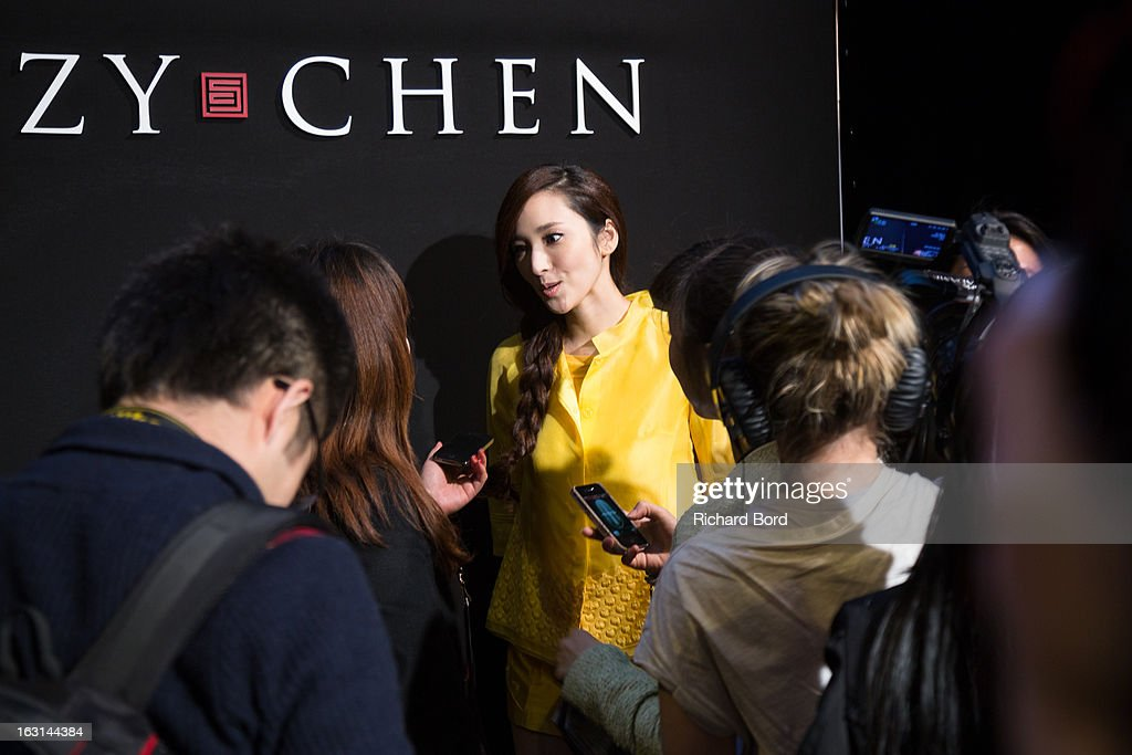Pace Wu Pei Ci speaks to media before the Shiatzy Chen Fall/Winter 2013 Ready-to-Wear show as part of Paris Fashion Week at Le Grand Palais on March 5, 2013 in Paris, France.