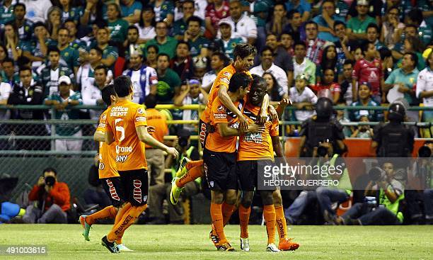 Pachuca players celebrate after scoring in their Mexican Clausura 2014 tournament football final first match against Leon at Nou Camp stadium on May...