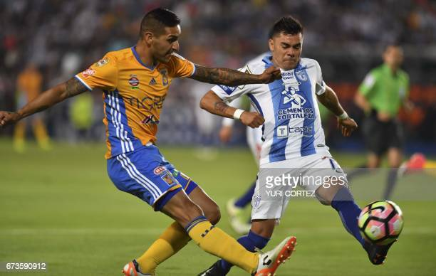 Pachuca's defender Emanuel Rodriguez vies for the ball with Tigres's forward Ismael Sosa during their CONCACAF Champions League final football match...