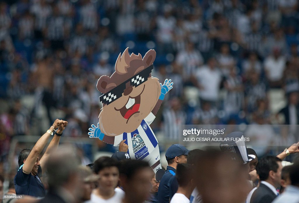 Pachuca's footballer players celebrate with his medal after winning the trophy following their win against Monterrey during their Mexican Clausura 2016 tournament football final match at the BBVA Bancomer stadium in Monterrey, Mexico on May, 29, 2016. / AFP / Julio Cesar Aguilar Fuentes