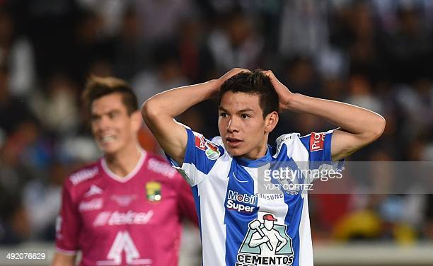 Pachuca's Hirving Lozano gestures after failing a chance to score next to Leon's Juan Gonzalez during their Clausura 2014 Mexican tournament final...
