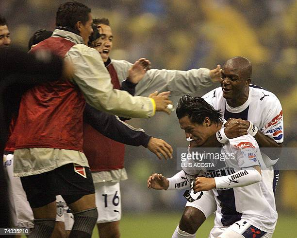 Pachuca's Juan Cacho celebrate Marvin Cabrera celebrates with teammates in their match against America during their Mexican Cup's final first match...