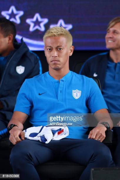 Pachuca's new footballer Japanese Keisuke Honda looks on during his official presentation at the Football University on the outskirts of Pachuca...