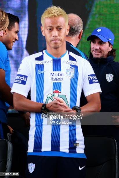 Pachuca's new footballer Japanese Keisuke Honda poses with the team's jersey during his official presentation at the Football University on the...