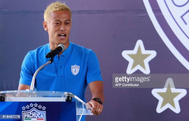 Pachuca's new footballer Japanese Keisuke Honda speaks during his official presentation at the Football University on the outskirts of Pachuca...