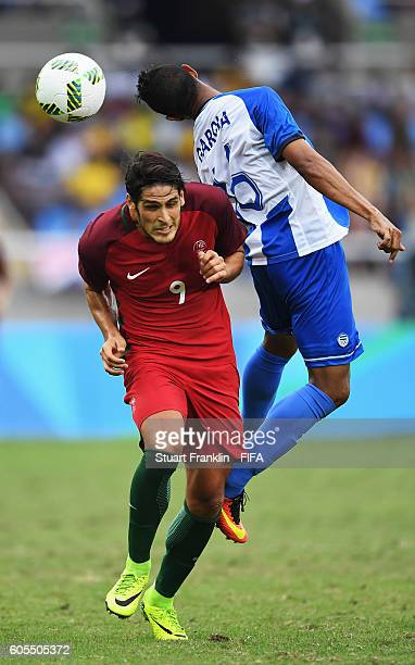 Paciencia of Portugal is challenged by Bryan Acosta of Honduras during the Olympic Men's Football match between Honduras and Portugal at Olympic...