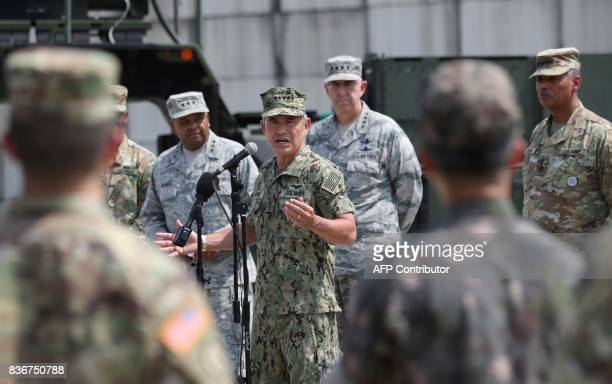 US Pacific Command Commander Admiral Harry Harris Jr answers a reporter's question as US and South Korean soldiers listen during a press conference...