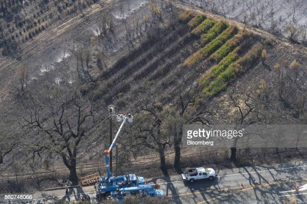 Pacific Gas and Electric Co crew repairing a downed power line damaged by wildfires are seen in this aerial photograph taken above Santa Rosa...