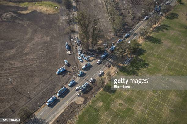 Pacific Gas and Electric Co crew repairing downed power lines damaged by wildfires are seen in this aerial photograph taken above Santa Rosa...