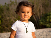 Toddler boy at the beach at sunset.