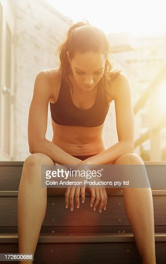Pacific Islander athlete sitting on steps