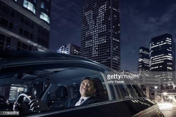 Pacific Islander businessman driving on city street
