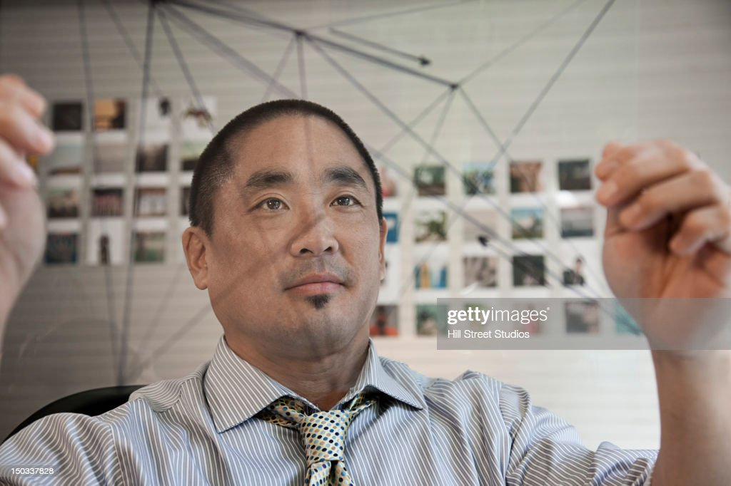 Pacific Islander businessman looking at diagram : Stock Photo