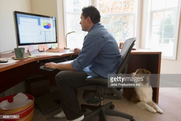 Pacific Islander businessman working at desk