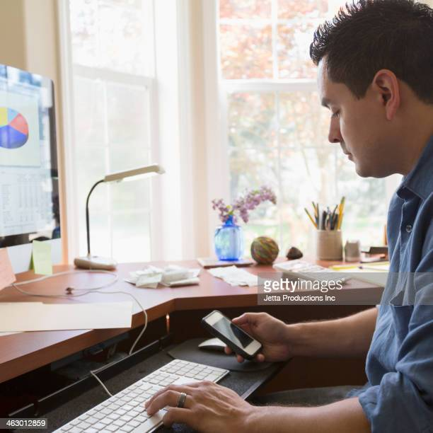 Pacific Islander businessman working at desk