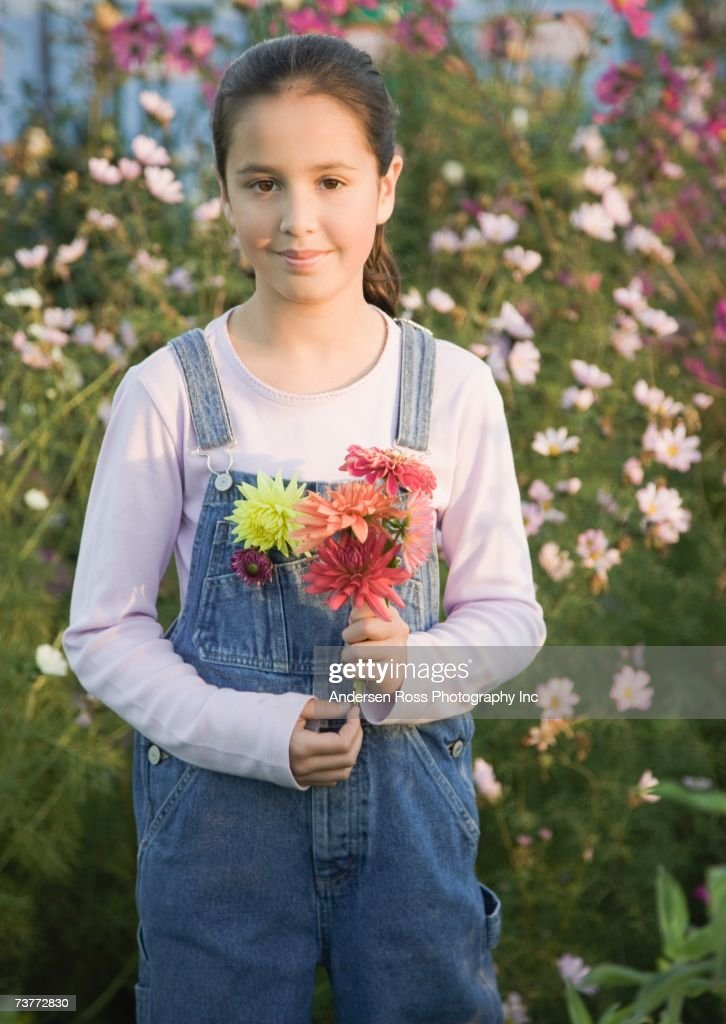 Pacific Islander girl holding wildflowers : Stock Photo