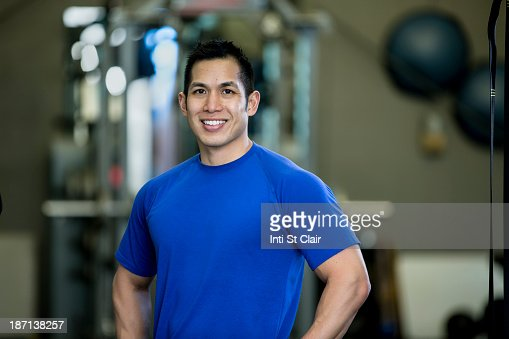 Pacific Islander man smiling in gym