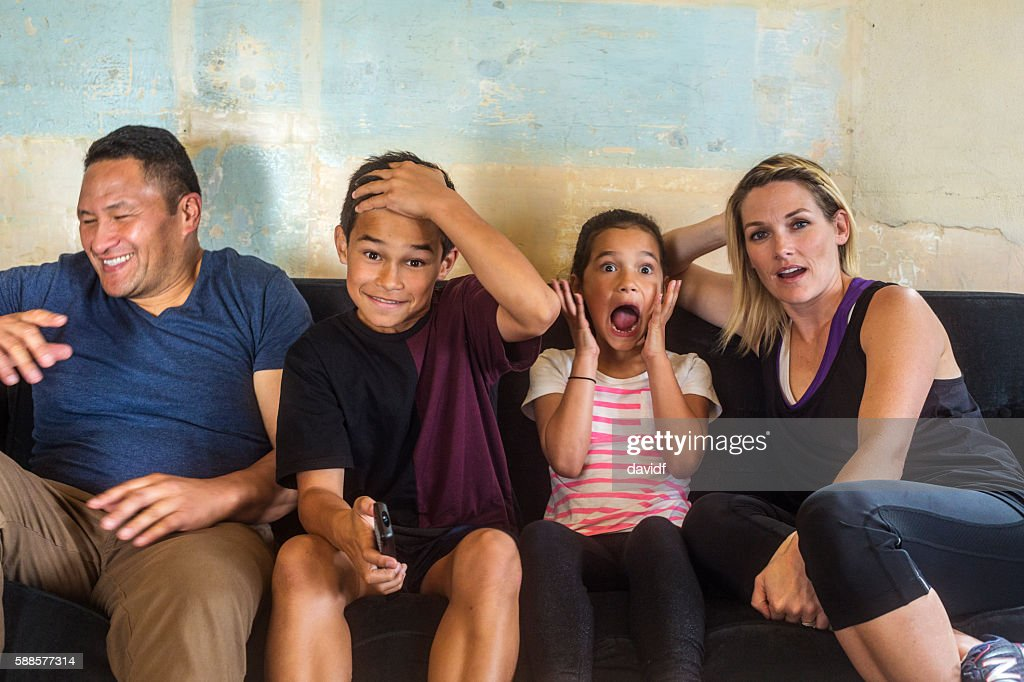 Pacific Islander Mixed Race Maori Family Watching Television Together : Stock Photo