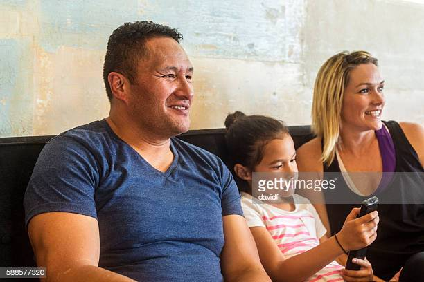 Pacific Islander Mixed Race Maori Family Watching Television Together