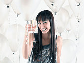 Pacific Islander woman drinking champagne