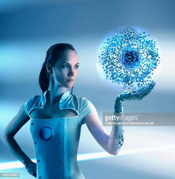 Pacific Islander woman holding glowing particle orb