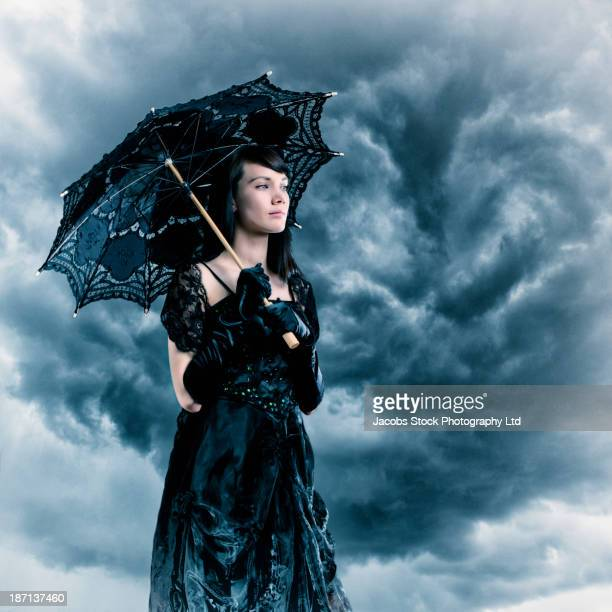 Pacific Islander woman in black gown