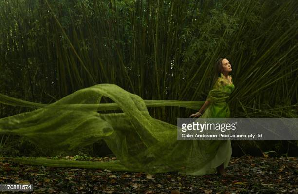 Pacific Islander woman in flowing green dress outdoors