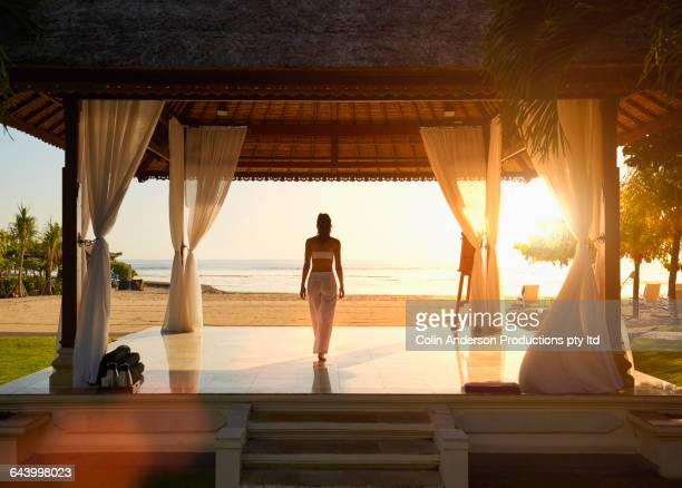 Pacific Islander woman in gazebo on beach
