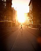 Pacific Islander woman jogging at sunset