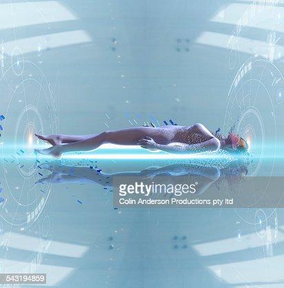 Pacific Islander woman laying in futuristic body scan