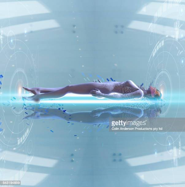 Pacific Islander woman laying in futuristic body scan