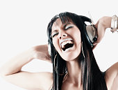 Pacific Islander woman listening to headphones
