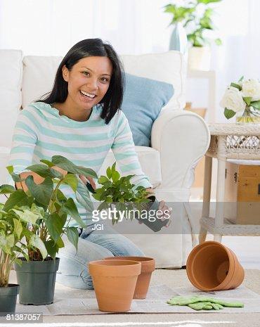 Pacific Islander woman re-potting plants