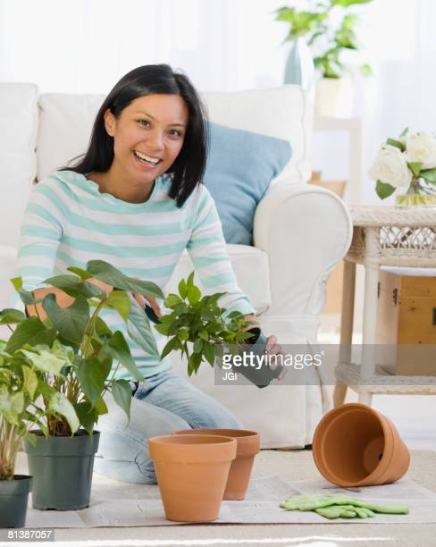 Pacific Islander woman re-potting plants