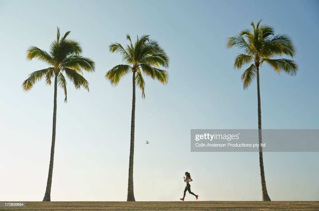 Pacific Islander woman running on beach