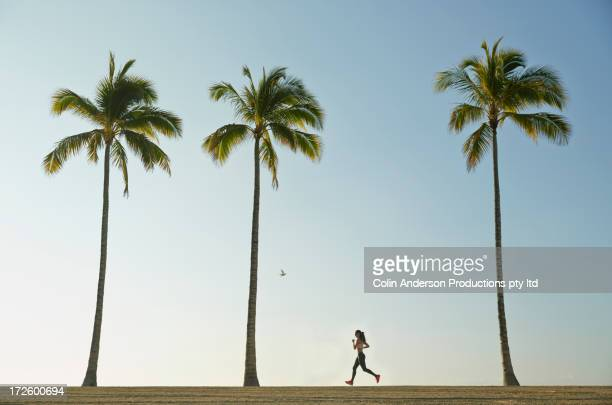Pacific Islander woman running on beach