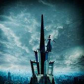 Pacific Islander woman scaling ornate skyscraper