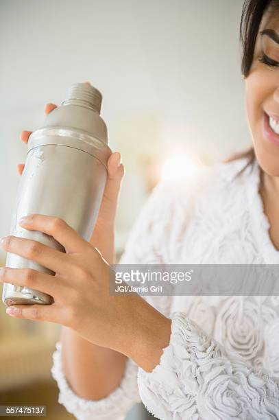 Pacific Islander woman shaking cocktail shaker