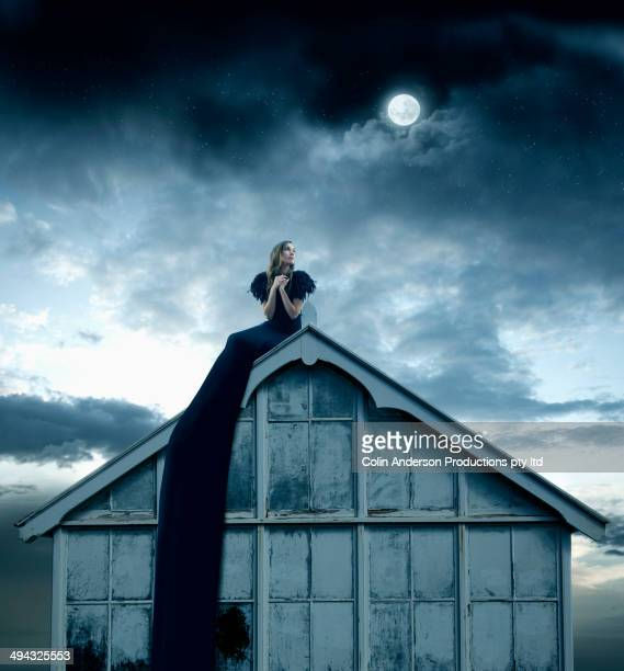 Pacific Islander woman sitting on rooftop