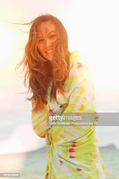 Pacific Islander woman smiling outdoors