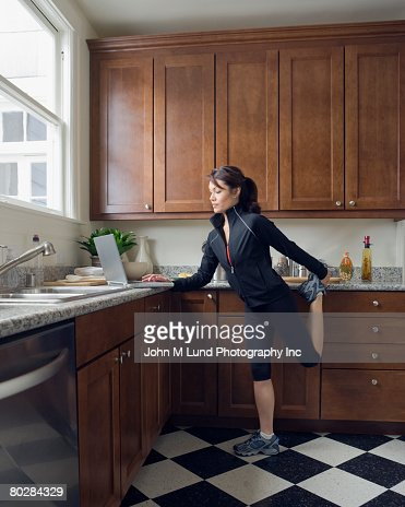 Pacific Islander woman stretching : Stock Photo